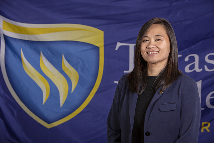 Photo of TXWES senior graphic designer and brand manager Paula Tran