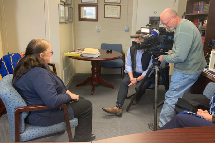 Photo of Associate Professor of Political Science Michelle Payne speaking with CBS 11 reporter Ken Molestina on a border funding proposal.