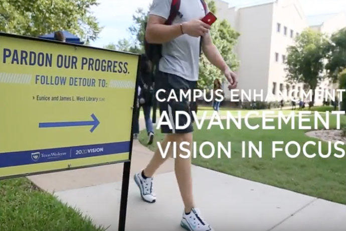Image of Pardon our Progress sign on campus as part of Texas Wesleyan's 2020 Vision in Focus video on Advancement.