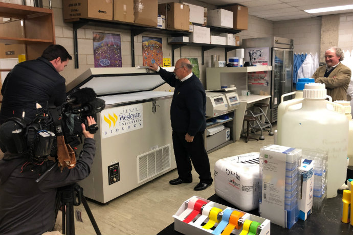 Photo of Dean Ricardo Rodriguez and Prof. Bruce Benz as they show WFAA one of two ultra-low bio freezers