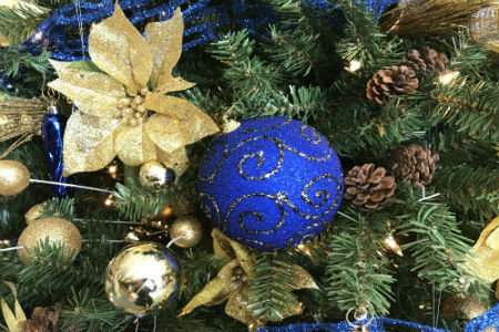 Photo of blue and gold decorated Christmas tree