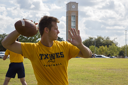 Texas Wesleyan football player throwing the football
