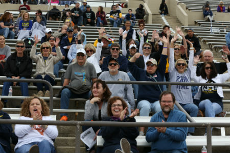 Faculty and staff cheer on the Rams at the spring Blue and Gold Scrimmage Football game on April 22, 2017