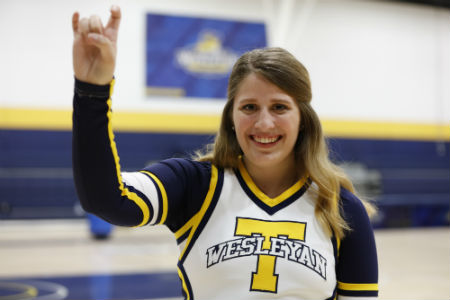 For Lyndsey Bessinger, senior management major at Texas Wesleyan University and Rams varsity cheerleader, cheering is more than a sport, it's her metaphor for life.
