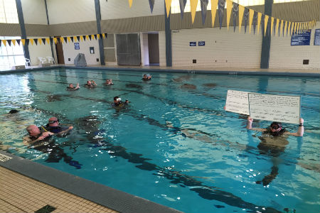 "Don't miss the country's only underwater graduation right here on campus! Scuba minors will get ""finned and pinned,"" while an underwater GoPro camera streams the action live to a big screen for spectators."