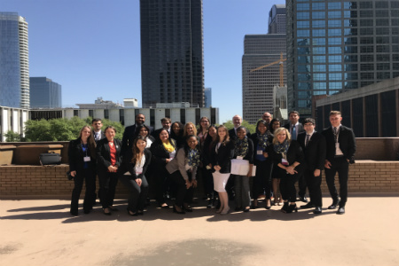 Chalon Anderson (gray jacket) and the Enactus team at the Dallas Regional competition.