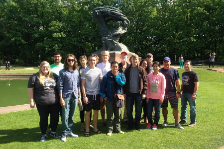 Seventeen Ethics & the Arts in Eastern Europe faculty and students at the Frederic Chopin Monument in Warsaw