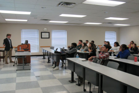 Accounting Society Guest Speaker Nikolaj Brons-Piche talking in front of students in a classroom