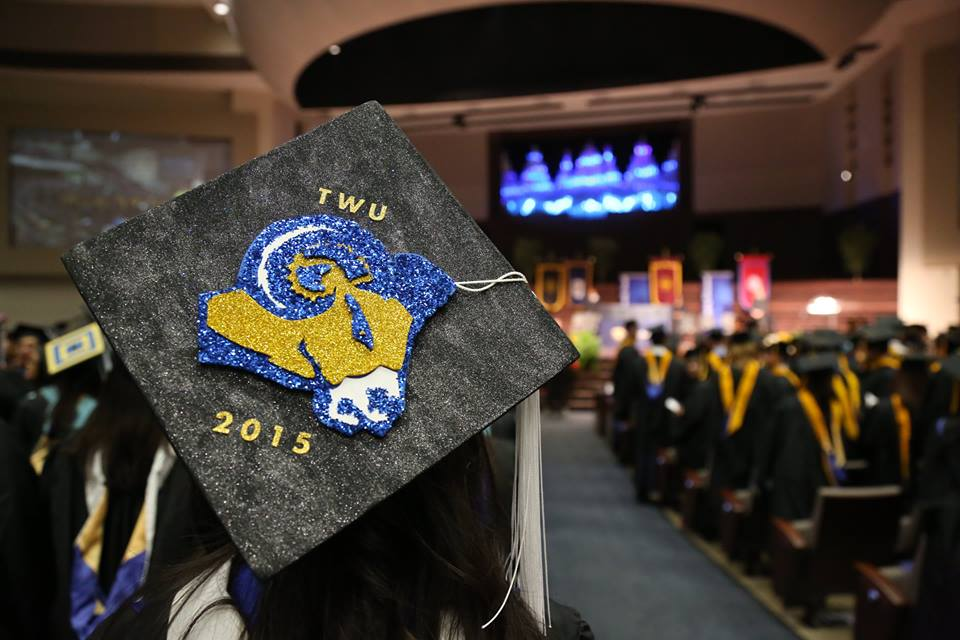Mortar board with ram at graduation ceremony