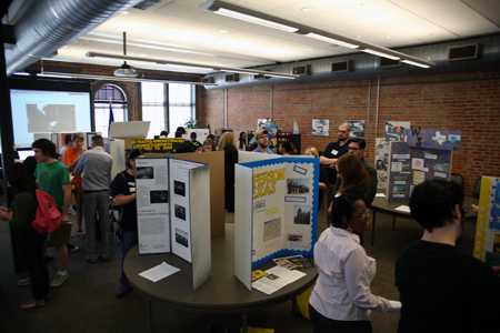 Students present posters in the Baker Building during the 2014 UCD event.
