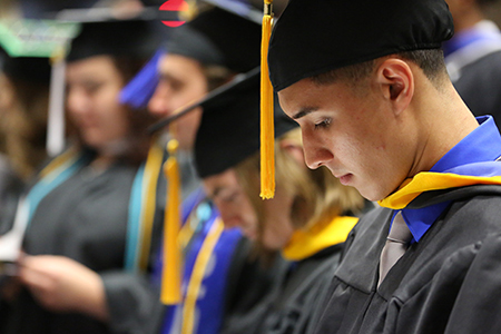 An image of graduates from the spring 2013 Commencement ceremony.