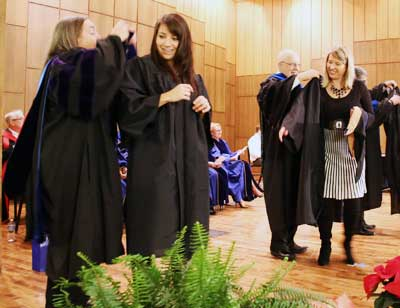 Students get their graduation robes at the December 2014 robing ceremony.