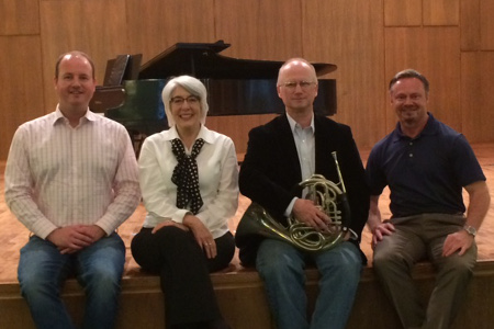 Professors and guest artists prepare for a recital.